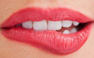 Прикусить губу — примета